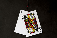 Hooked On Gambling With Black Background Royalty Free Stock Photos