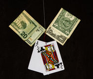 Hooked On Gambling With Black Background Stock Photo
