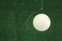 Hooked golf ball stock images