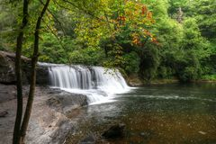 Free Hooker Falls And Autumn Begins Stock Photos - 58771263