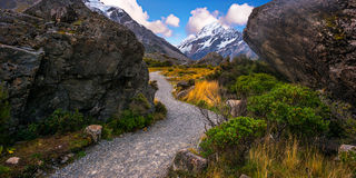 Hooker Valley path towards Hooker Lake, New Zealand on a clear blue sky day. Royalty Free Stock Photos
