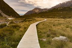 Hooker Valley track, wooden path into Fox mountain. New Zealand natural landscape Royalty Free Stock Photos