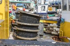 Hooks basins on fishing boat Stock Photos
