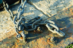 Hooks And Chains On Concrete Stock Image