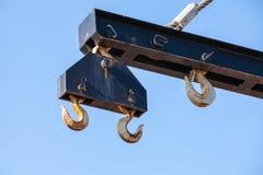 Hooks hanging on beam of harbor crane Stock Image