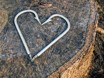 Hooks heart. Hooks on shape like heart on the wooden background Royalty Free Stock Images