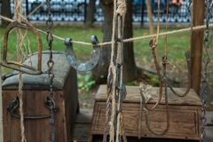 Hooks, horseshoes, chains hanging on the rope. stock photos