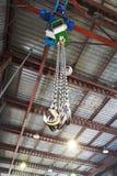 Hooks of weigher bridge crane in warehouse Stock Images