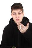 Hooligan com um cigarro Fotografia de Stock