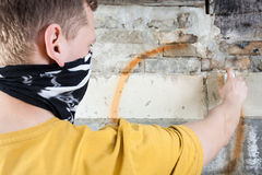 Hooligan painting graffiti Royalty Free Stock Photos