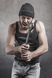 Hooligan shouting a threatening with a wrench Royalty Free Stock Image
