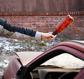 Hooligan smashing windshield Stock Photography