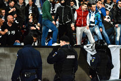 Hooliganism during a football game Stock Photos