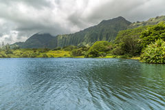 Hoomaluhia Gardens Lake. A view of the Koolau mountains as seen from the lake at Hoomaluhia Botanical Gardens in Kaneohe on Oahu, Hawaii Royalty Free Stock Images