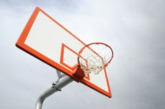 Hoop Dreams. A upward view of a basketball ball hop with a sky backround Stock Photography