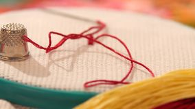 Hoop with embroidery, confidant, threads and floss stock footage