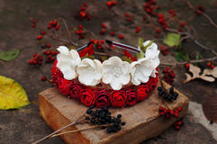 Hoop from flowers, wreath with colored flowers. Handmade flowers wreath on outdoor metal stand.  Accessory. Artificial flowers, ha Stock Images