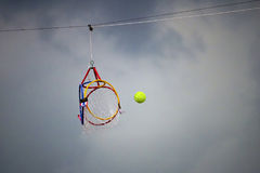 Hoop Sepaktakraw Asian Sport. A green rattan ball floating to the hoop. Hoop Sepaktakraw Royalty Free Stock Photography