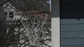 Hoop from the side. A side view of a garage basketball hoop Stock Image