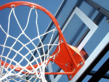 Hoop There It Is. A clean, colorful basketball hoop under a summer sky Royalty Free Stock Photos