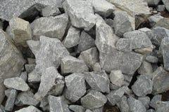 Hoop van grijze grote stenen stock foto's