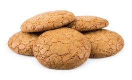 Hoop van ronde bruine die koekjes op wit worden geïsoleerd Royalty-vrije Stock Afbeeldingen