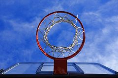 Hoops. Basketball hoop from below looking up into the bright blue sky Stock Photos