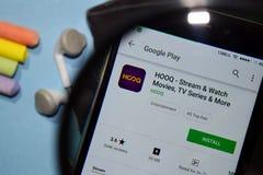 HOOQ - Stream & Watch Movies, TV Series & More dev app with magnifying on Smartphone screen. BEKASI, WEST JAVA, INDONESIA. DECEMBER 27, 2018 : HOOQ - Stream & royalty free stock photo