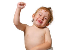 Hooray. Young boy smiling a holding his fist in the air stock photos
