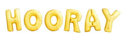 Hooray ord som göras av isolerade guld- uppblåsbara ballonger på vit royaltyfri fotografi
