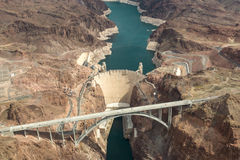 Hoover Dam Aerial View. Aerial view of the Colorado River Bridge and the Hoover Dam in Nevada, Arizona, USA. There is a hydroelectric power station, a bridge and Royalty Free Stock Photo