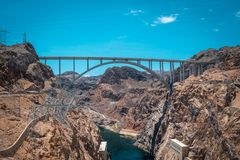 Hoover Dam and the Colorado River. Electricity production in the USA. Tourist attraction of Nevada and Arizona, USA. The Hoover Dam and the arch bridge over the Stock Images