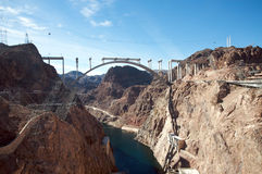 Hoover Dam and the Hoover Dam Bypass Bridge. During construction Stock Image