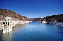 Hoover dam. Low water levels in reservoir along Hoover Dam in American southwest Stock Photography
