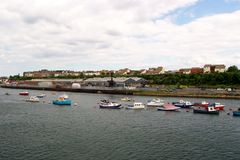 Colourful boats on swinging moorings in Newcastle Royalty Free Stock Photos