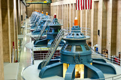 Hoover Dam Turbines. View inside of the historic Hoover Dam plant. Hoover Dam, is a popular tourist destination and was once known as Boulder Dam, is a concrete Royalty Free Stock Images