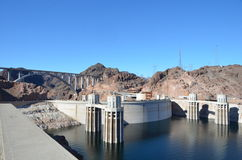 Hoover Dam view from Arizona side. Sunny morning view of the Hoover Dam from the Arizona side with the highway bridge in the background Stock Photos