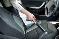 Hoovering a car cabin Royalty Free Stock Images