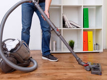 Hoovering a parquet floor Stock Photography
