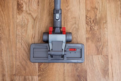 Hoovering a parquet floor Royalty Free Stock Image