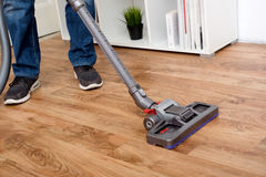 Hoovering a parquet floor wooden Royalty Free Stock Images