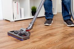 Hoovering a parquet Stock Photos
