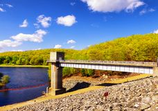 Hop brook dam Naugatuck. The lake side of Hop Brook Dam in Naugatuck connecticut on a sunny blue sky day royalty free stock photos