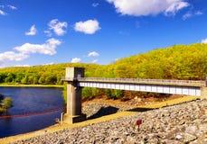 Hop brook dam Naugatuck. The lake side of Hop Brook Dam in Naugatuck connecticut on a sunny blue sky day Royalty Free Stock Photos