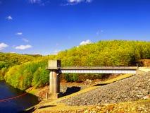 Hop brook dam Naugatuck. The lake side of Hop Brook Dam in Naugatuck connecticut on a sunny blue sky day Stock Photo