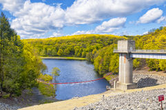 Hop brook dam Naugatuck. The lake side of Hop Brook Dam in Naugatuck connecticut on a sunny blue sky day Stock Photos