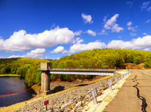 Hop brook dam Naugatuck. The lake side of Hop Brook Dam in Naugatuck connecticut on a sunny blue sky day Royalty Free Stock Images
