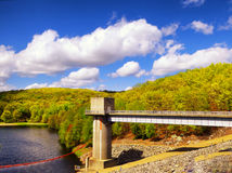 Hop brook dam Naugatuck. The lake side of Hop Brook Dam in Naugatuck connecticut on a sunny blue sky day royalty free stock photography