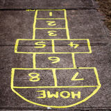 Hop Home. Lets play hopscotch on the footpath out the front Stock Photo