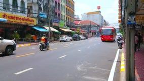 Hop on hop off bus in Bangkok, Thailand. BANGKOK, THAILAND - APRIL 22, 2019: Hop on hop off bus drives along the busy Phra Sumen Road of Banglampoo tourist stock footage